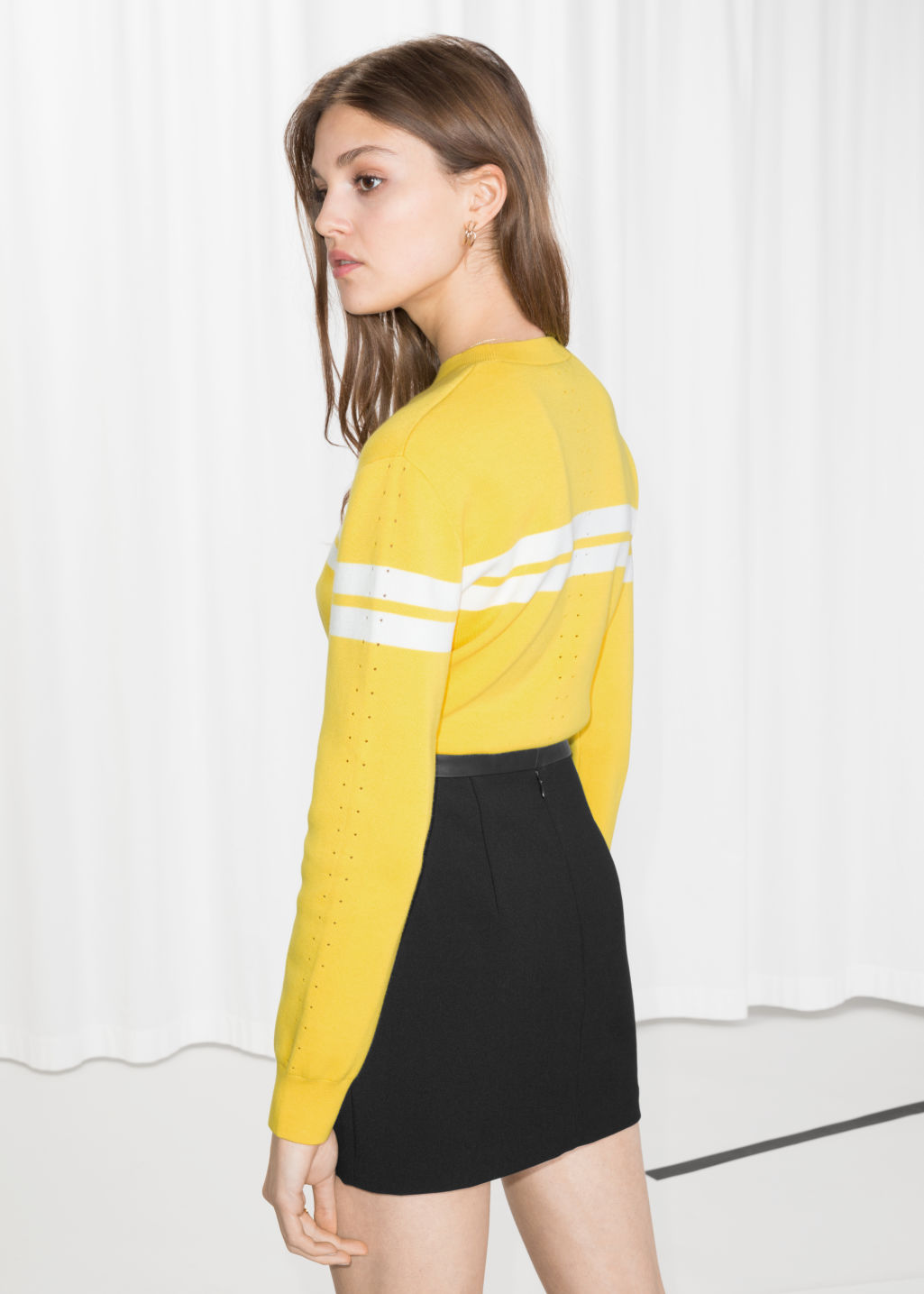 Model back image of Stories duo stripe pullover in yellow