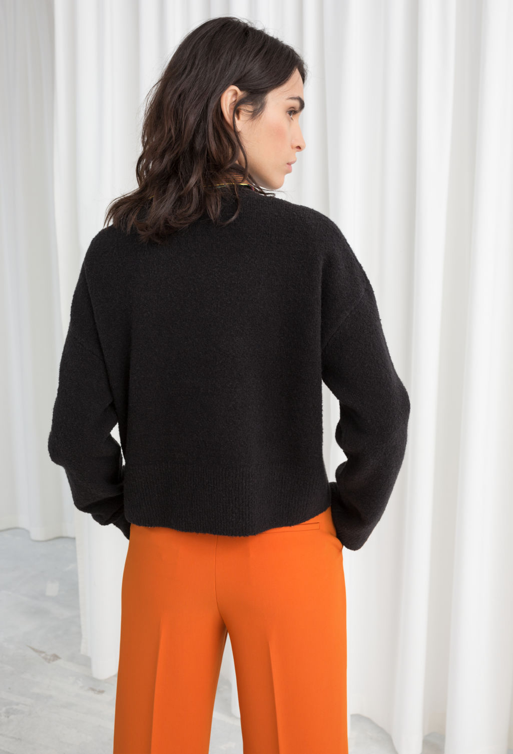 Model back image of Stories cropped sweater  in black
