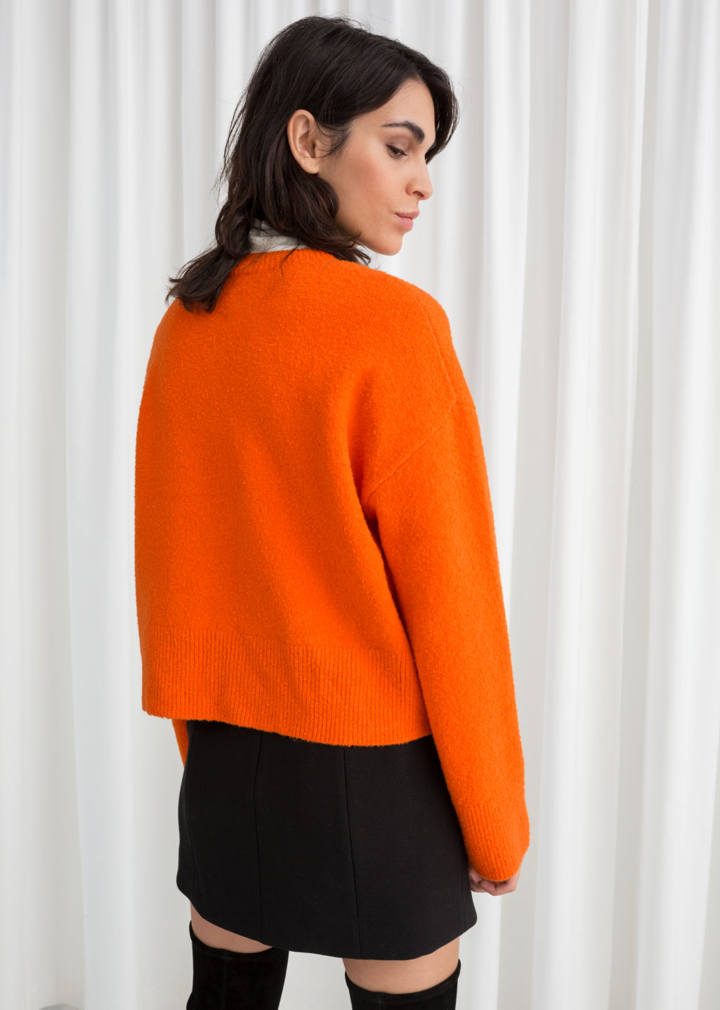 Model back image of Stories cropped sweater  in orange