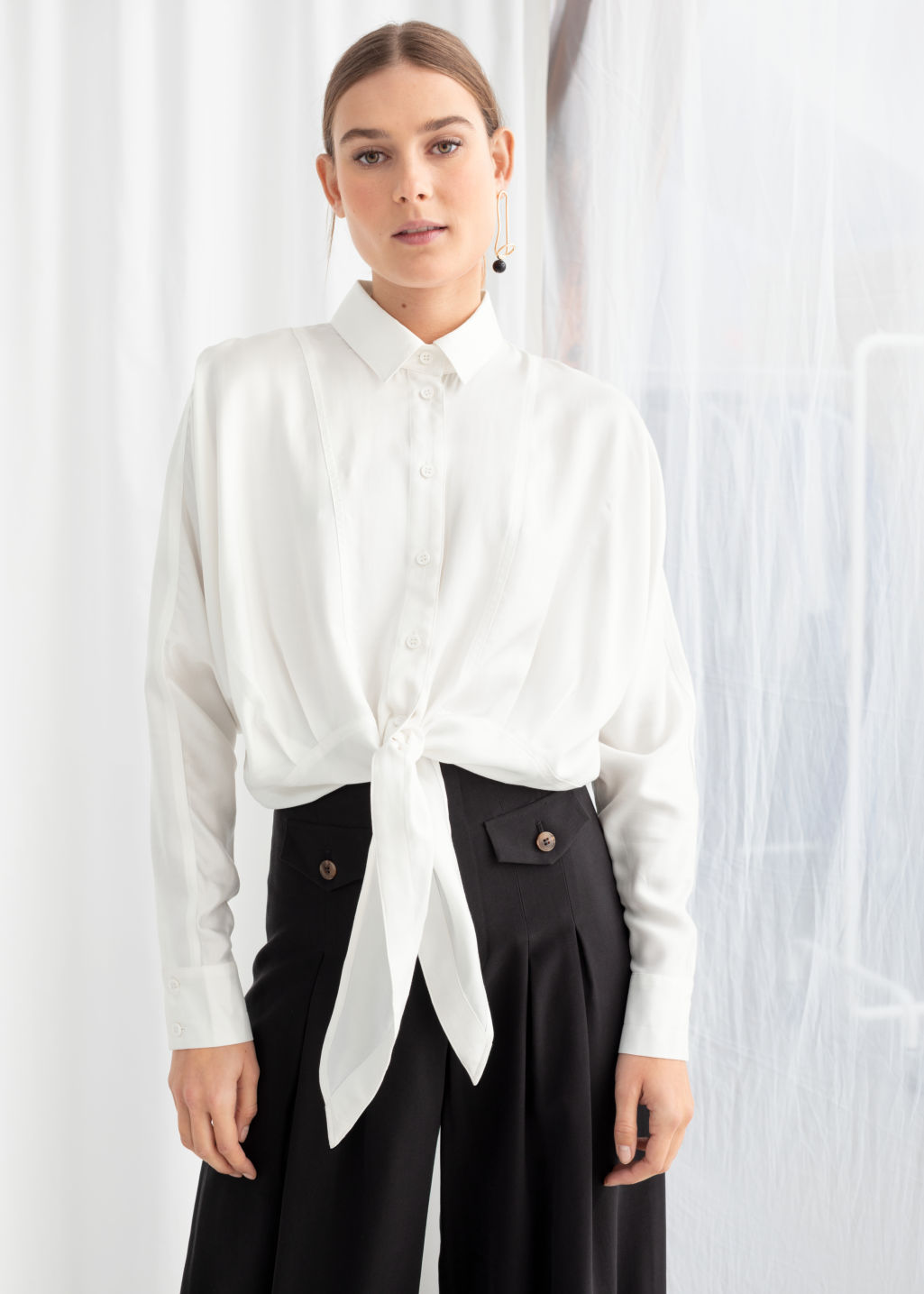 Model front image of Stories front tie button down in white