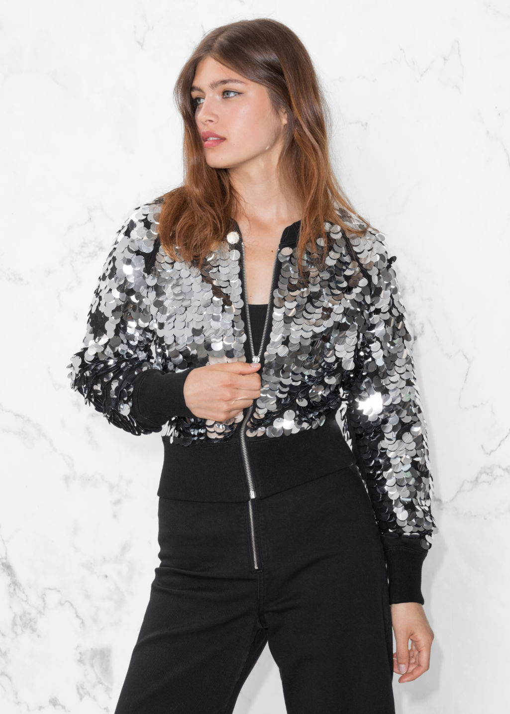 Model front image of Stories sequin jacket in black