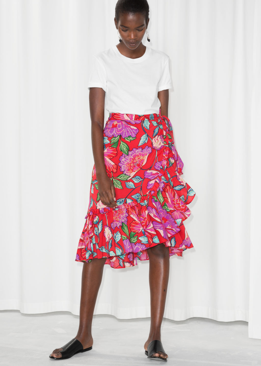 Model front image of Stories sheer floral ruffle midi skirt in red