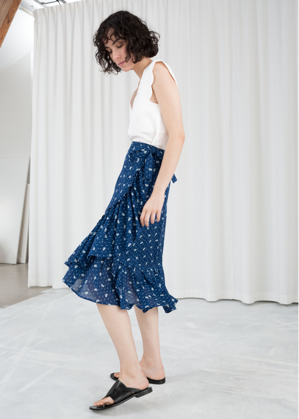 Model front image of Stories floral ruffle midi skirt in blue