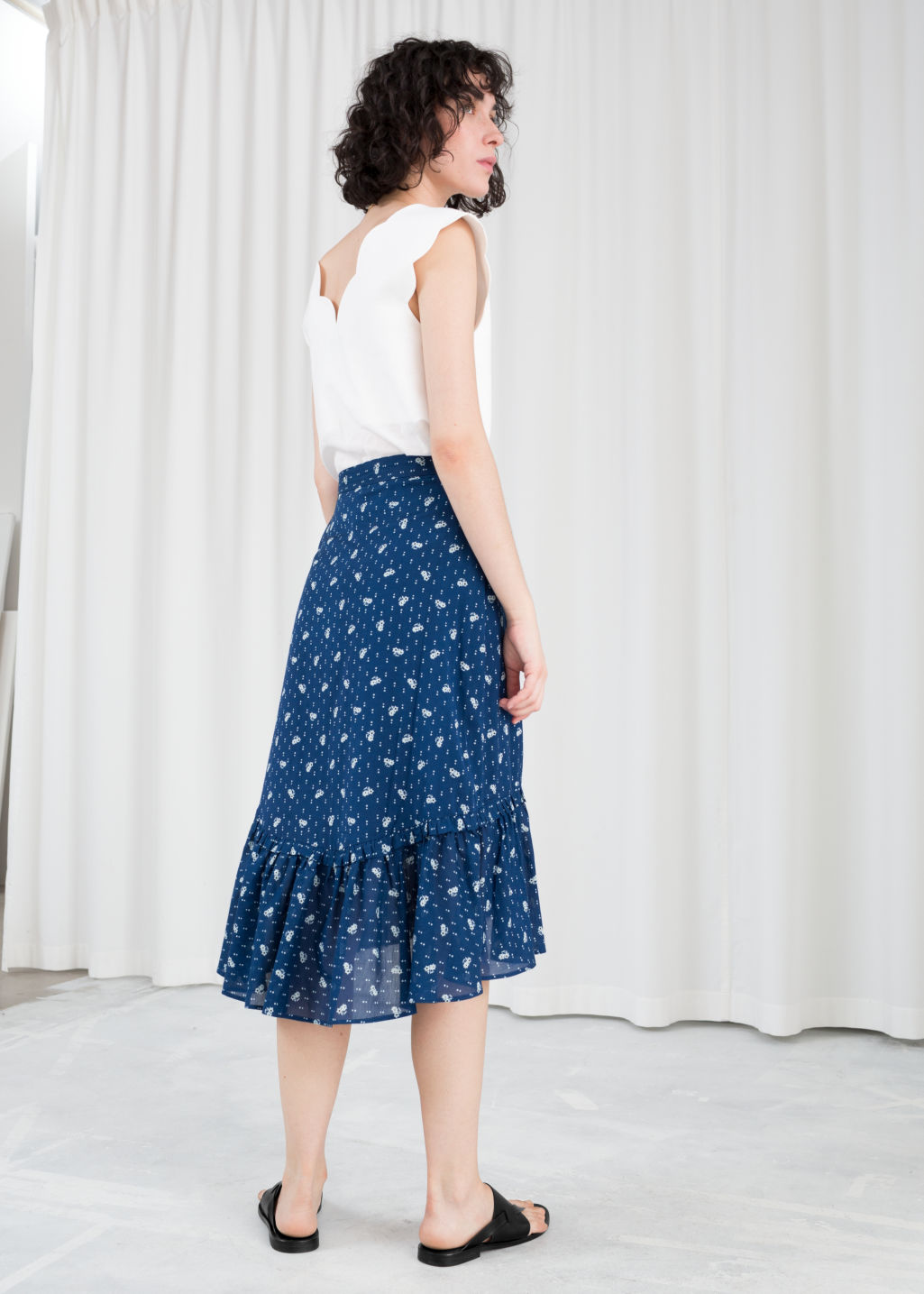 Model back image of Stories floral ruffle midi skirt in blue