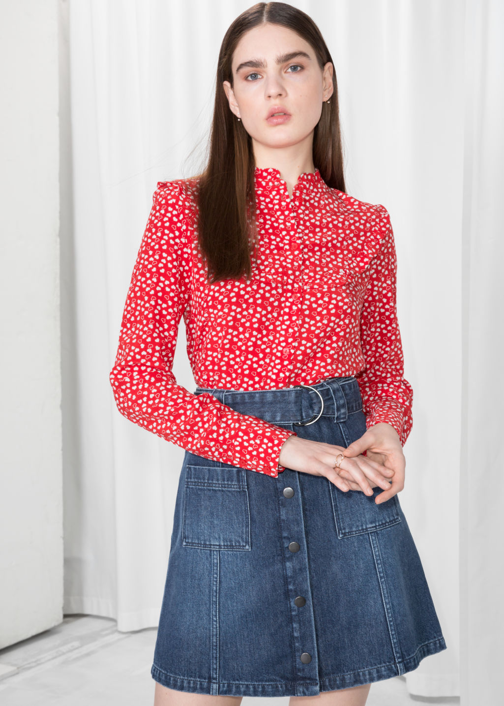 Model front image of Stories heart print ruffle blouse  in red