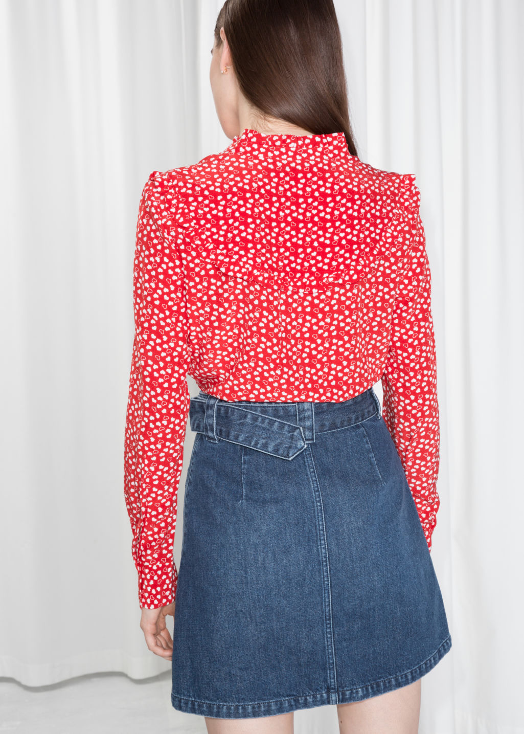 Model back image of Stories heart print ruffle blouse  in red