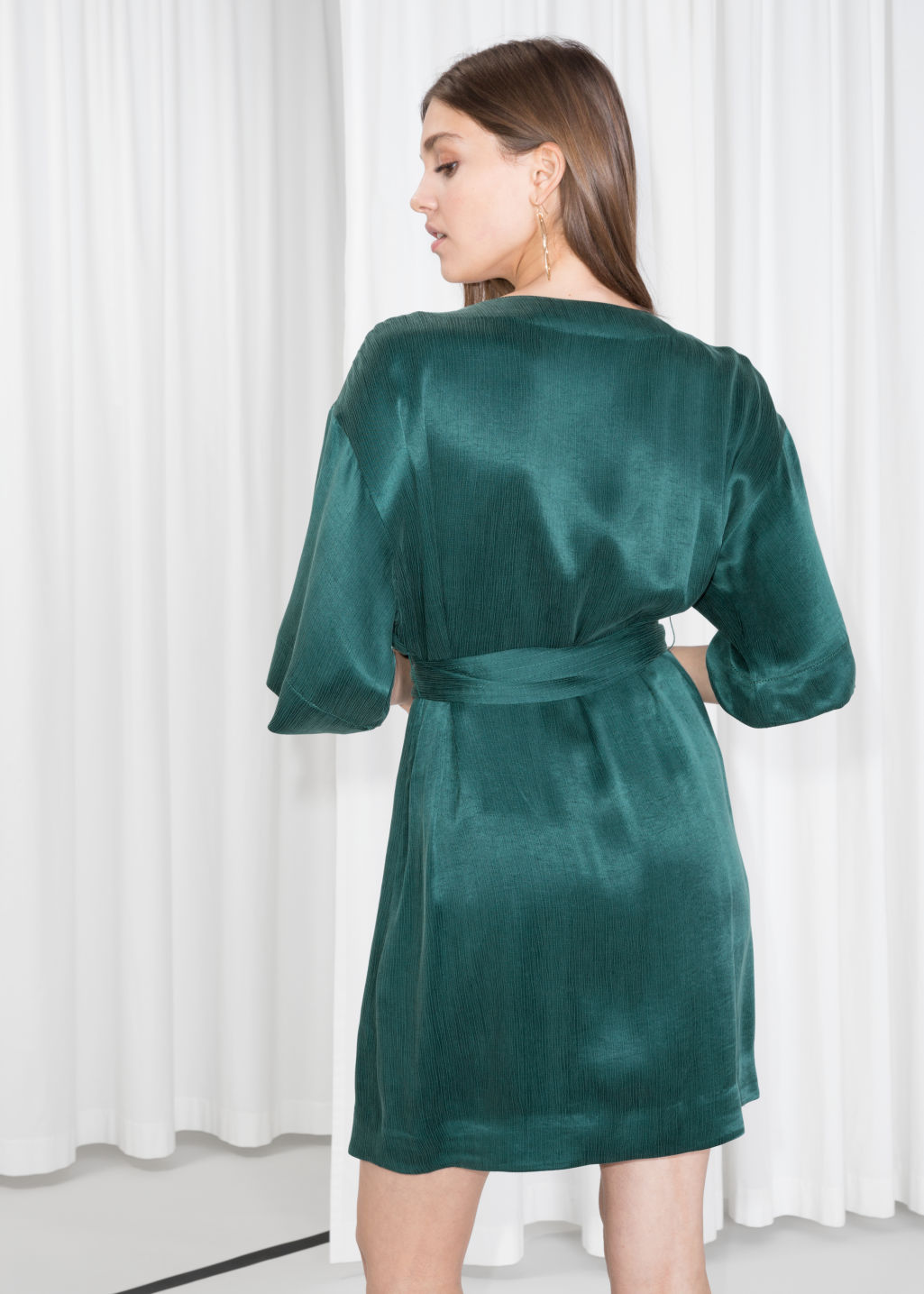 Model back image of Stories wrap dress in turquoise