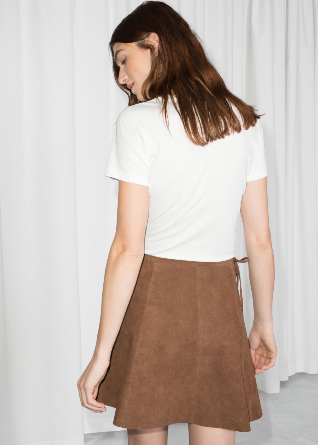 Model back image of Stories wrap suede mini skirt in beige