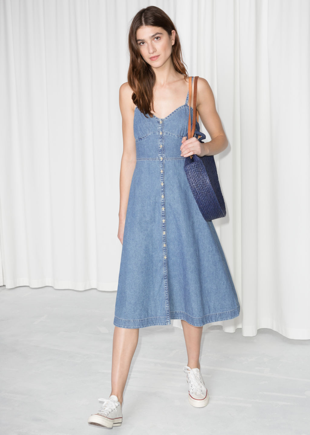 Model back image of Stories fit and flare denim dress in blue