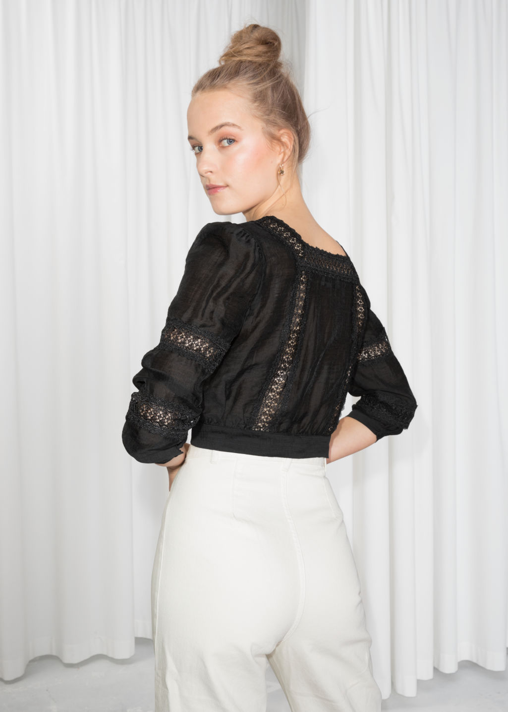Model back image of Stories eyelet trim cropped blouse in black