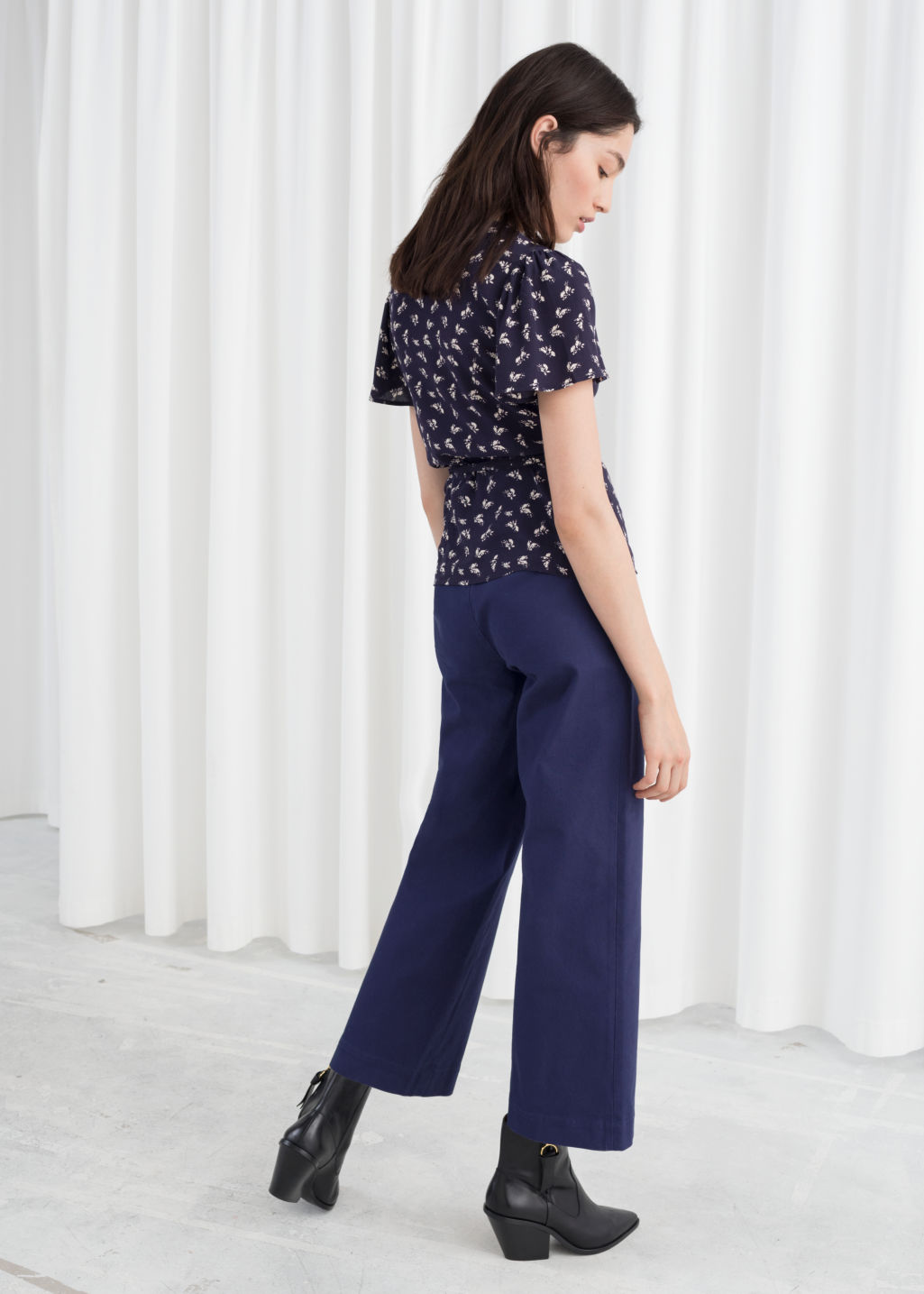 Model back image of Stories high waisted twill trousers in blue