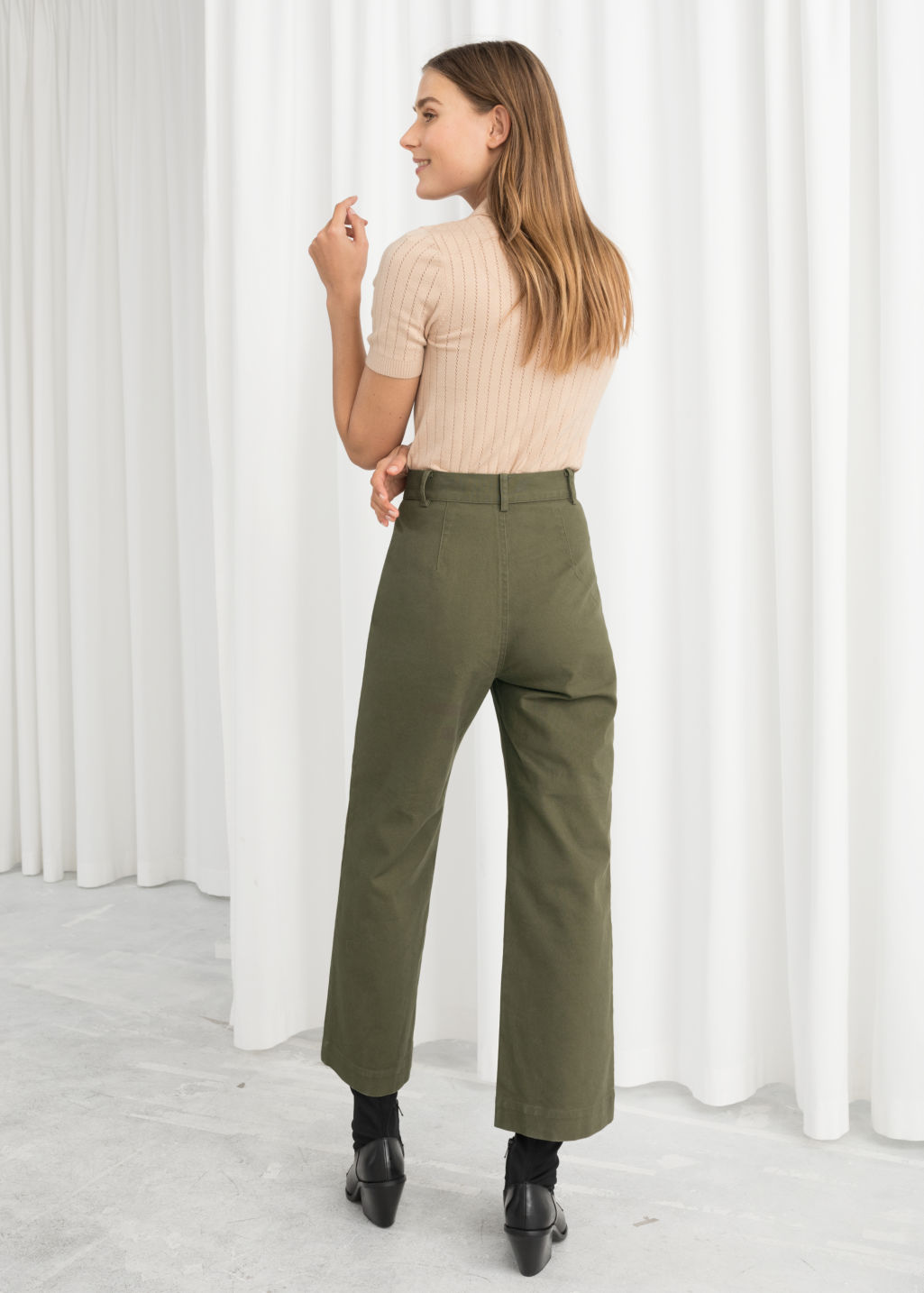 Model back image of Stories high waisted twill trousers in green