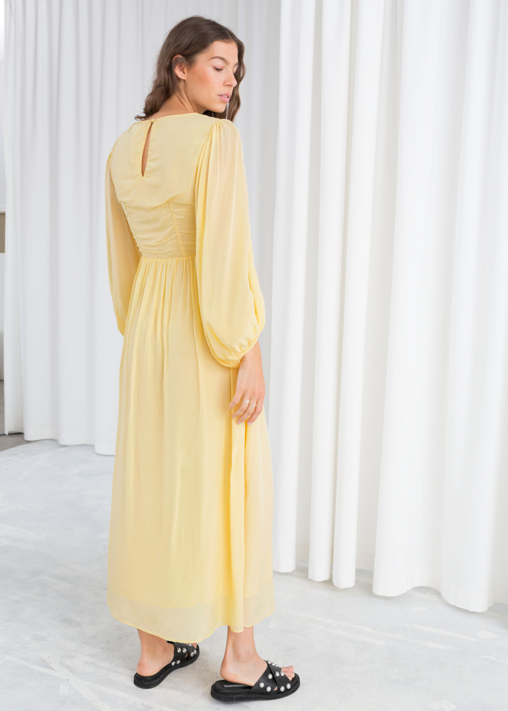 Model back image of Stories billowy prarie maxi dress in yellow