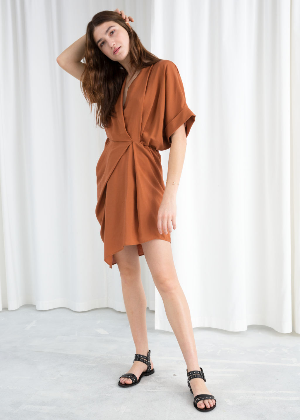 Model front image of Stories asymmetrical gathered wrap dress in orange