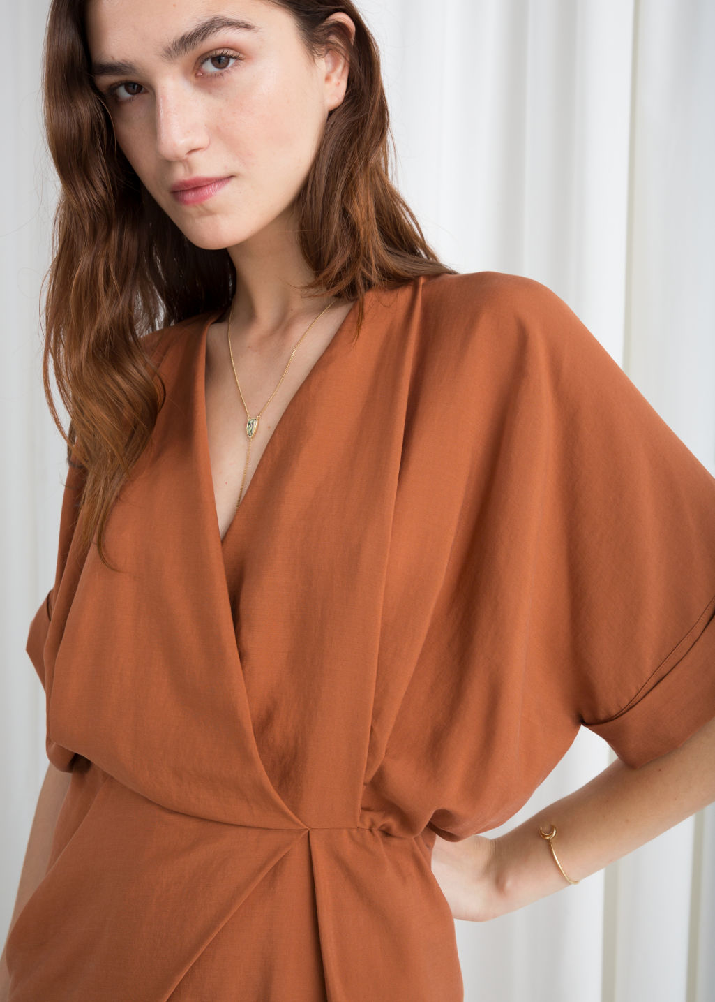 Model back image of Stories asymmetrical gathered wrap dress in orange