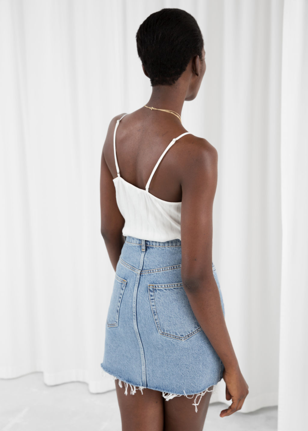 Model back image of Stories  in white