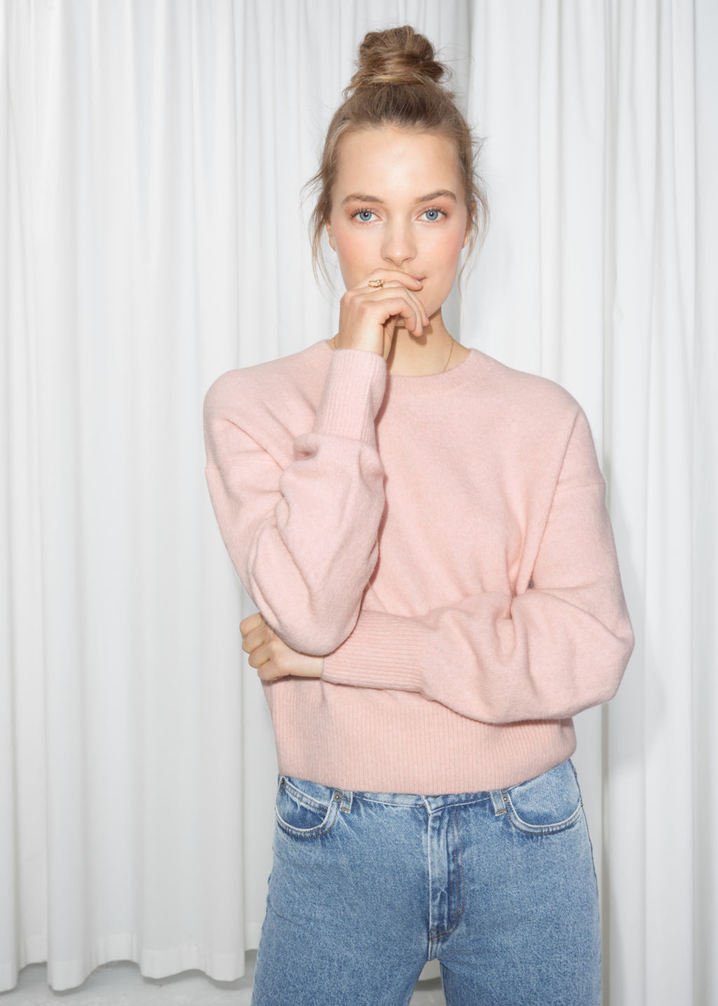 Model front image of Stories crewneck sweater in pink