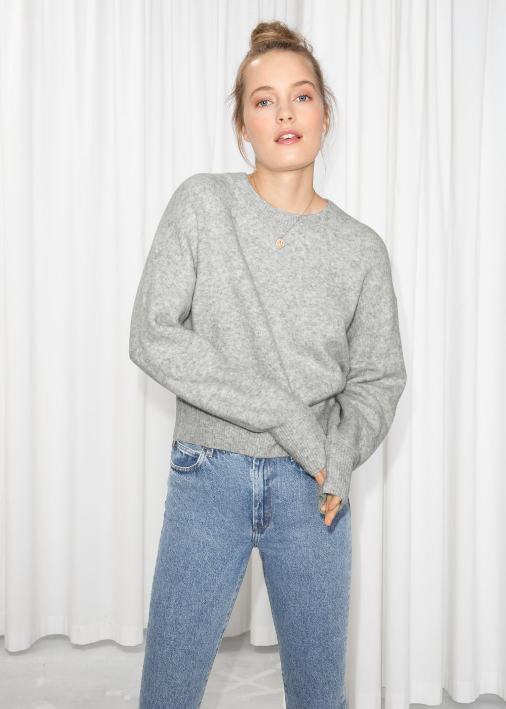 Model front image of Stories crewneck sweater in grey