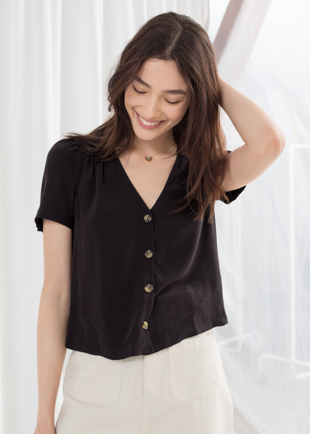 Model front image of Stories button down blouse  in black
