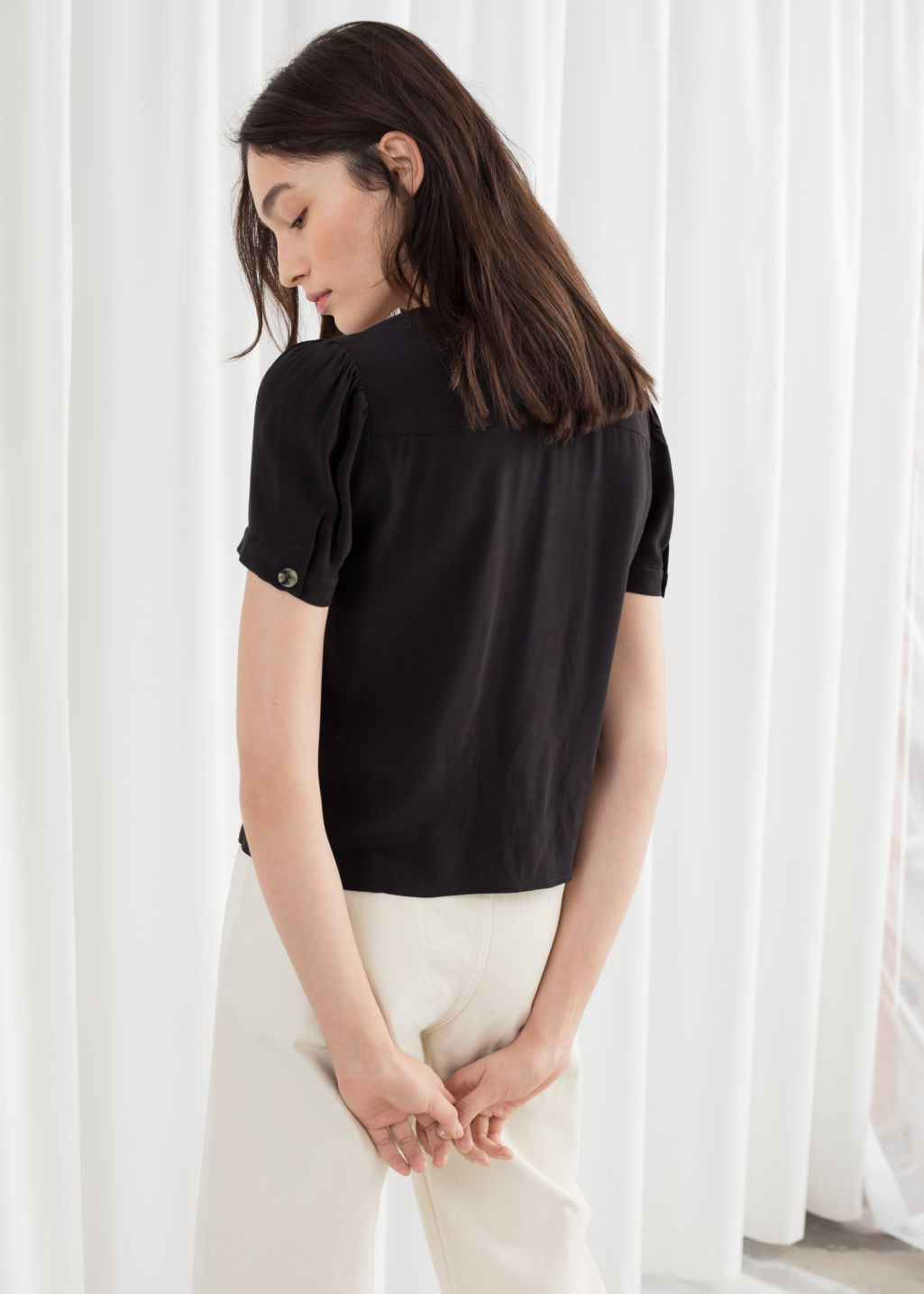 Model back image of Stories button down blouse  in black