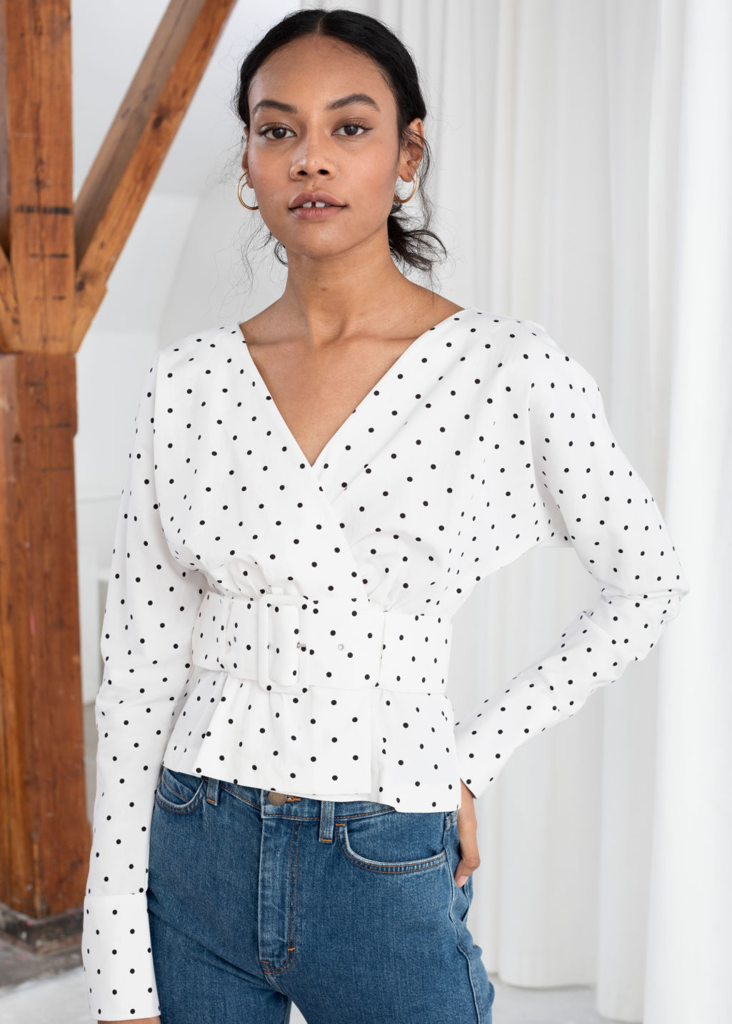 Model front image of Stories belted blouse in white