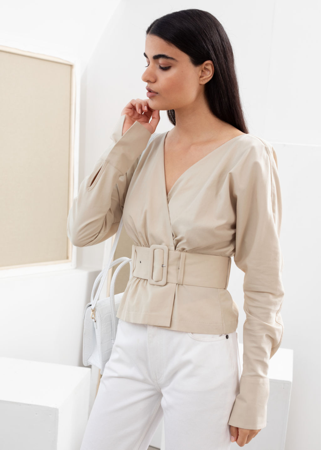 Model front image of Stories belted blouse in beige