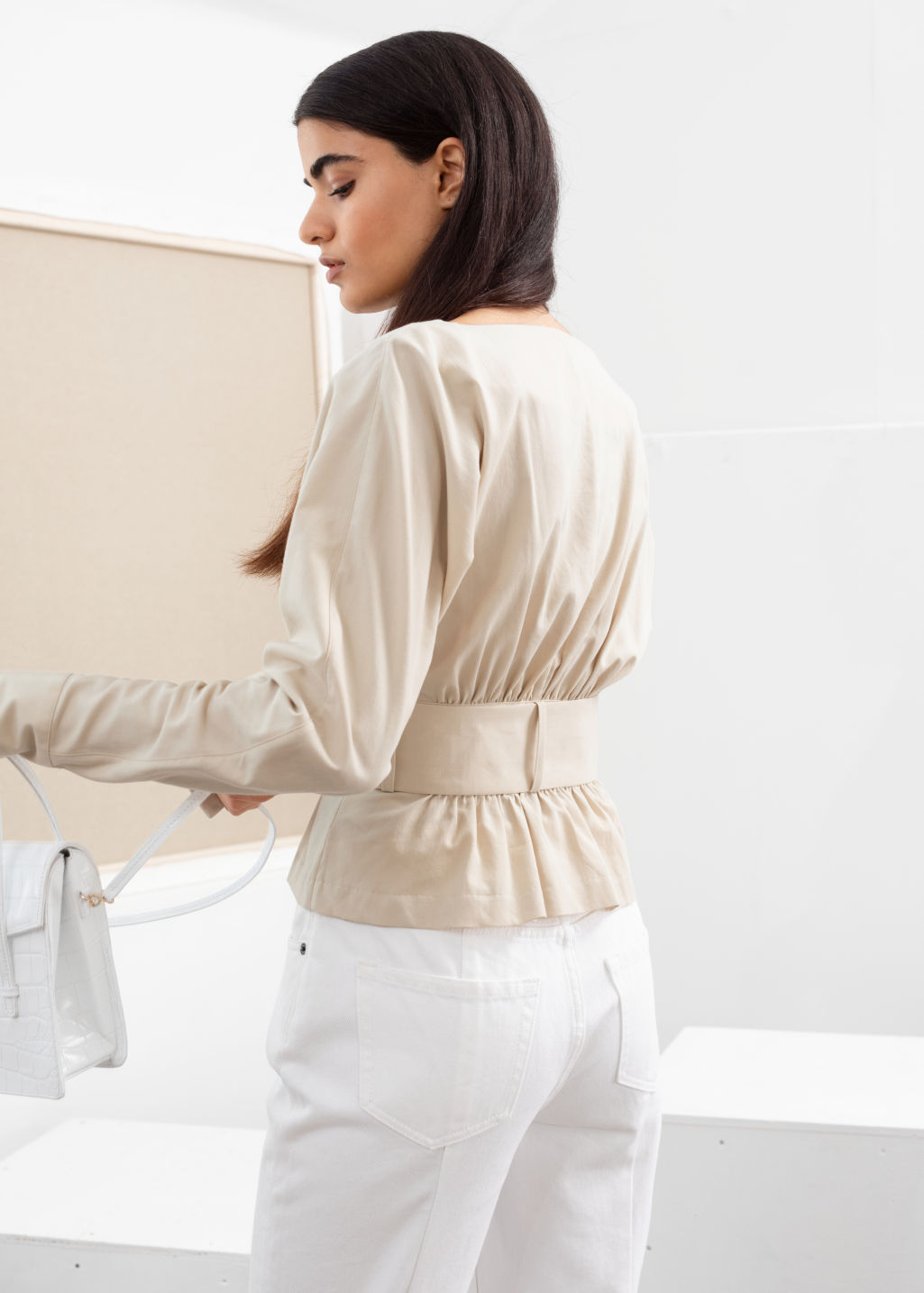 Model back image of Stories belted blouse in beige