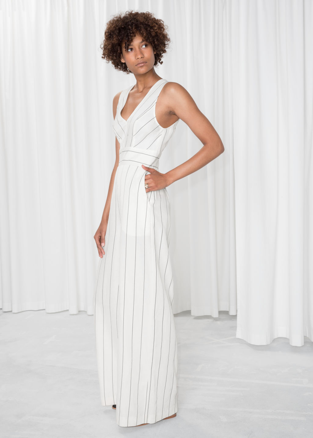 Model front image of Stories striped sleeveless jumpsuit  in white