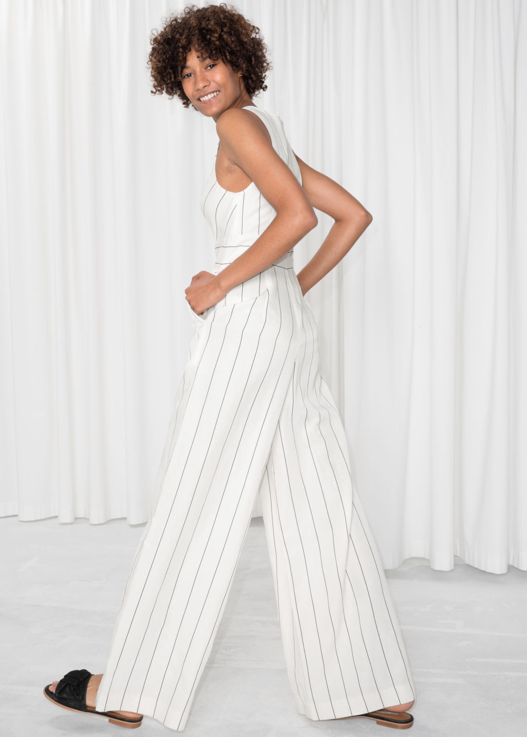 Model back image of Stories striped sleeveless jumpsuit  in white