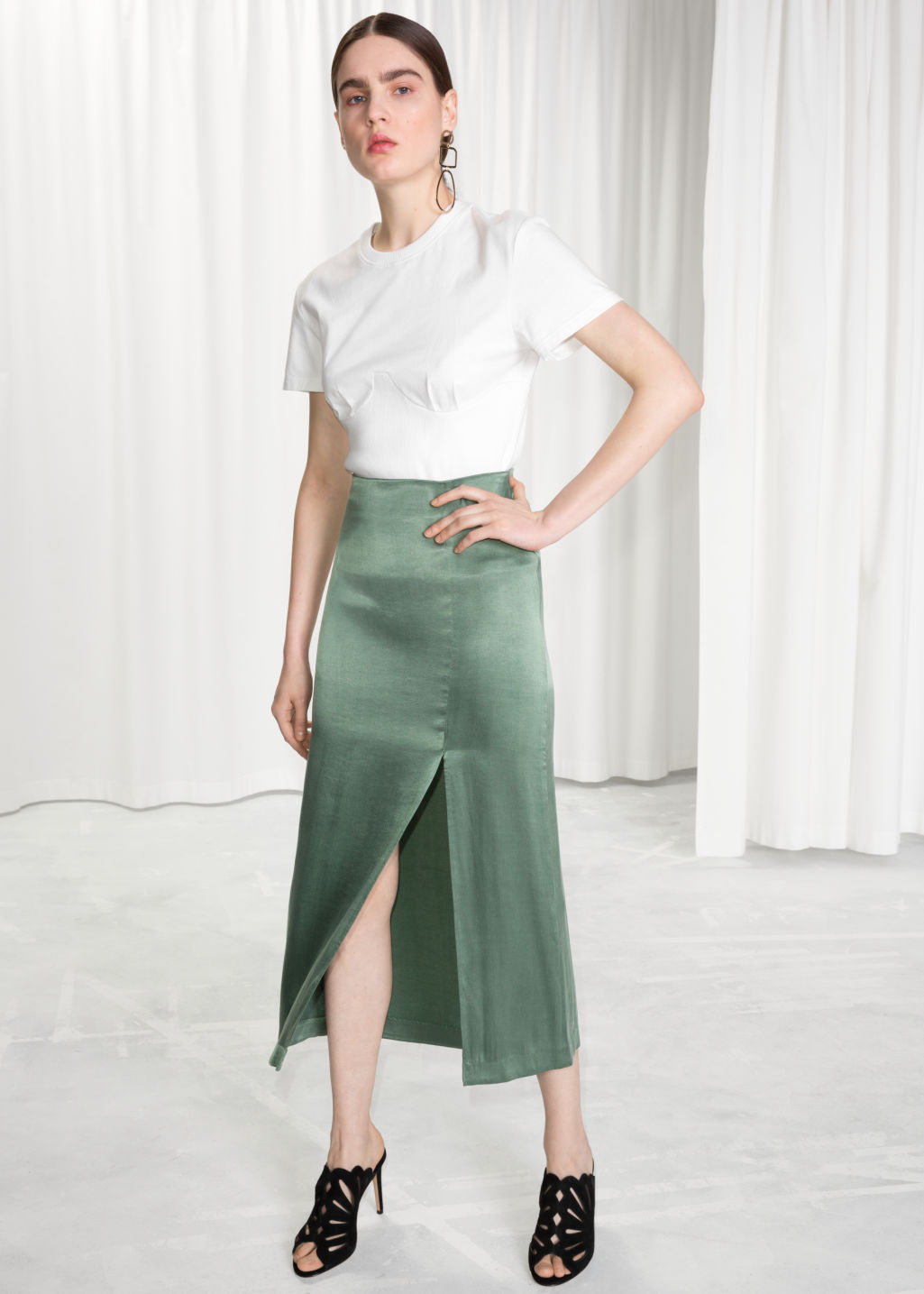 Model front image of Stories side slit midi skirt in green