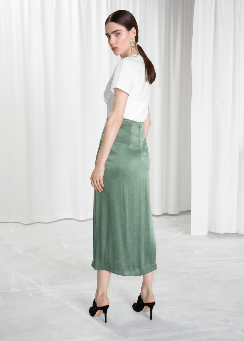 Model back image of Stories side slit midi skirt in green