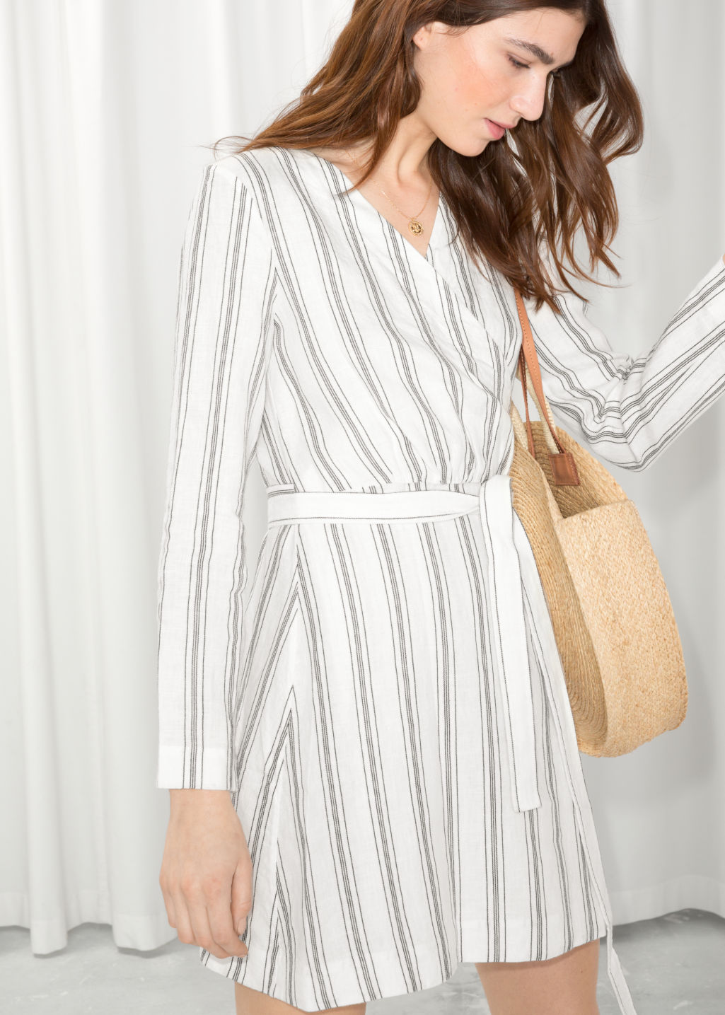 Model front image of Stories striped wrap dress in white