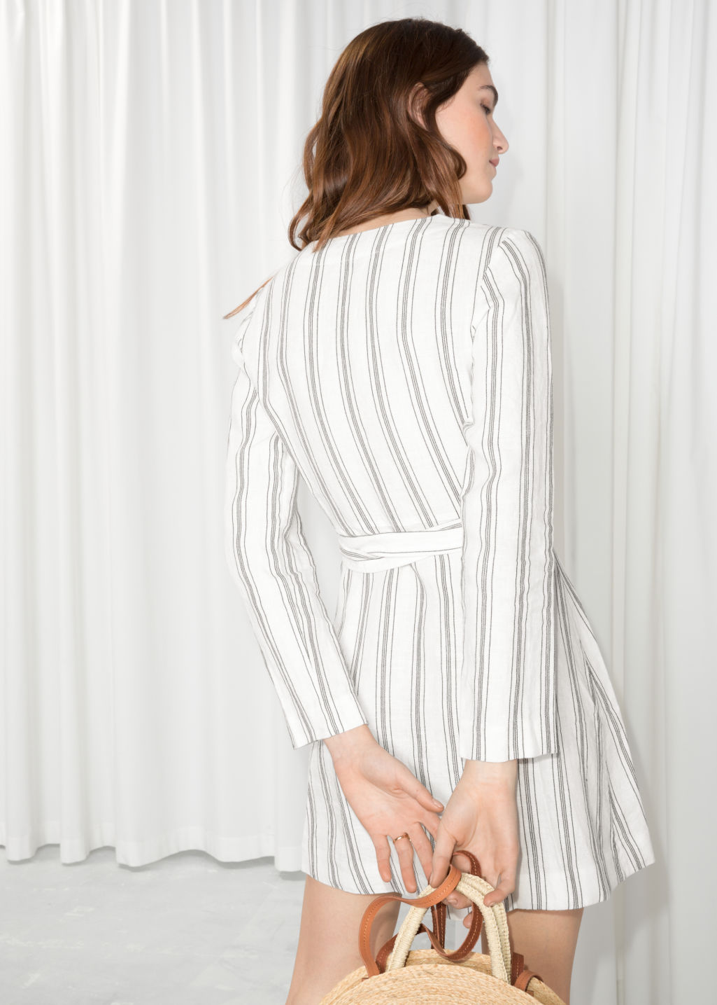 Model back image of Stories striped wrap dress in white