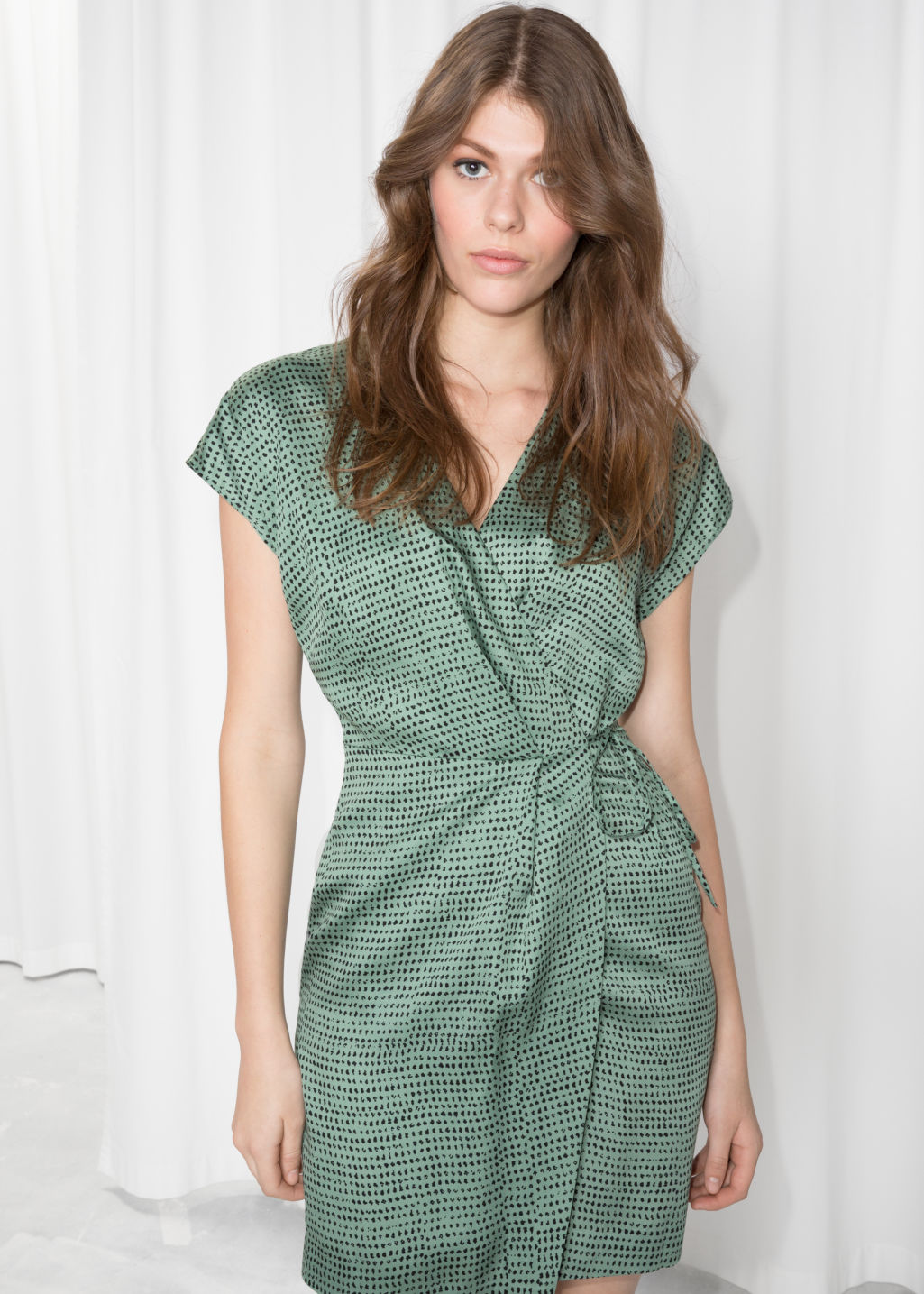 Model front image of Stories sleeveless wrap dress in green