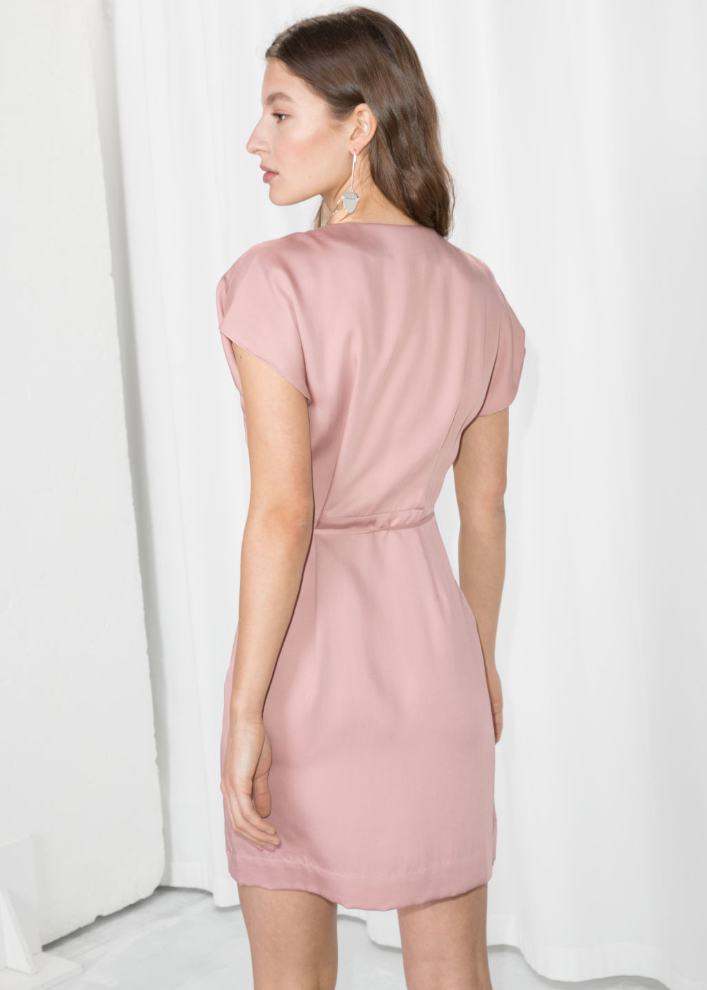 Model back image of Stories sleeveless wrap dress in pink