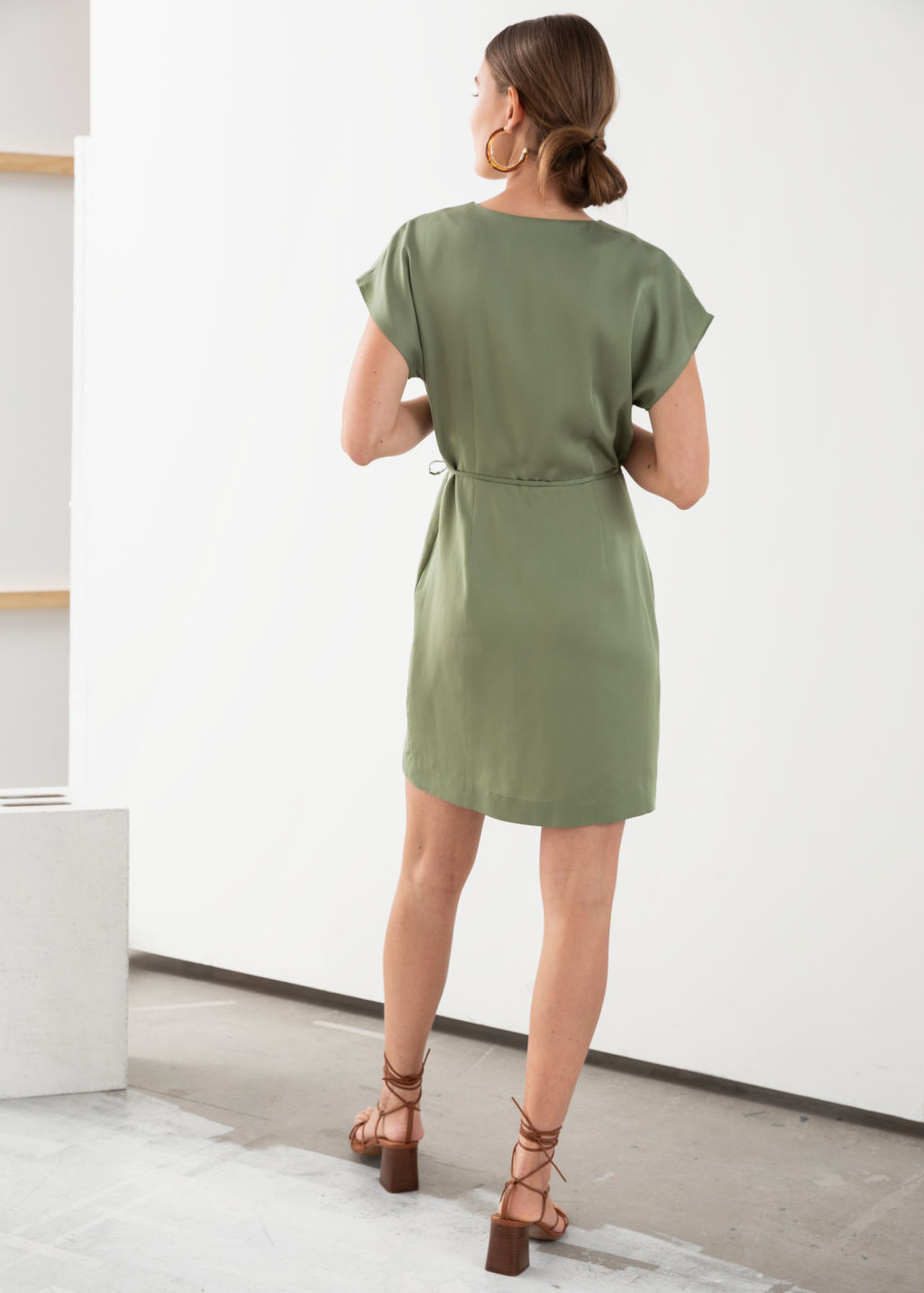 Model back image of Stories sleeveless wrap dress in green