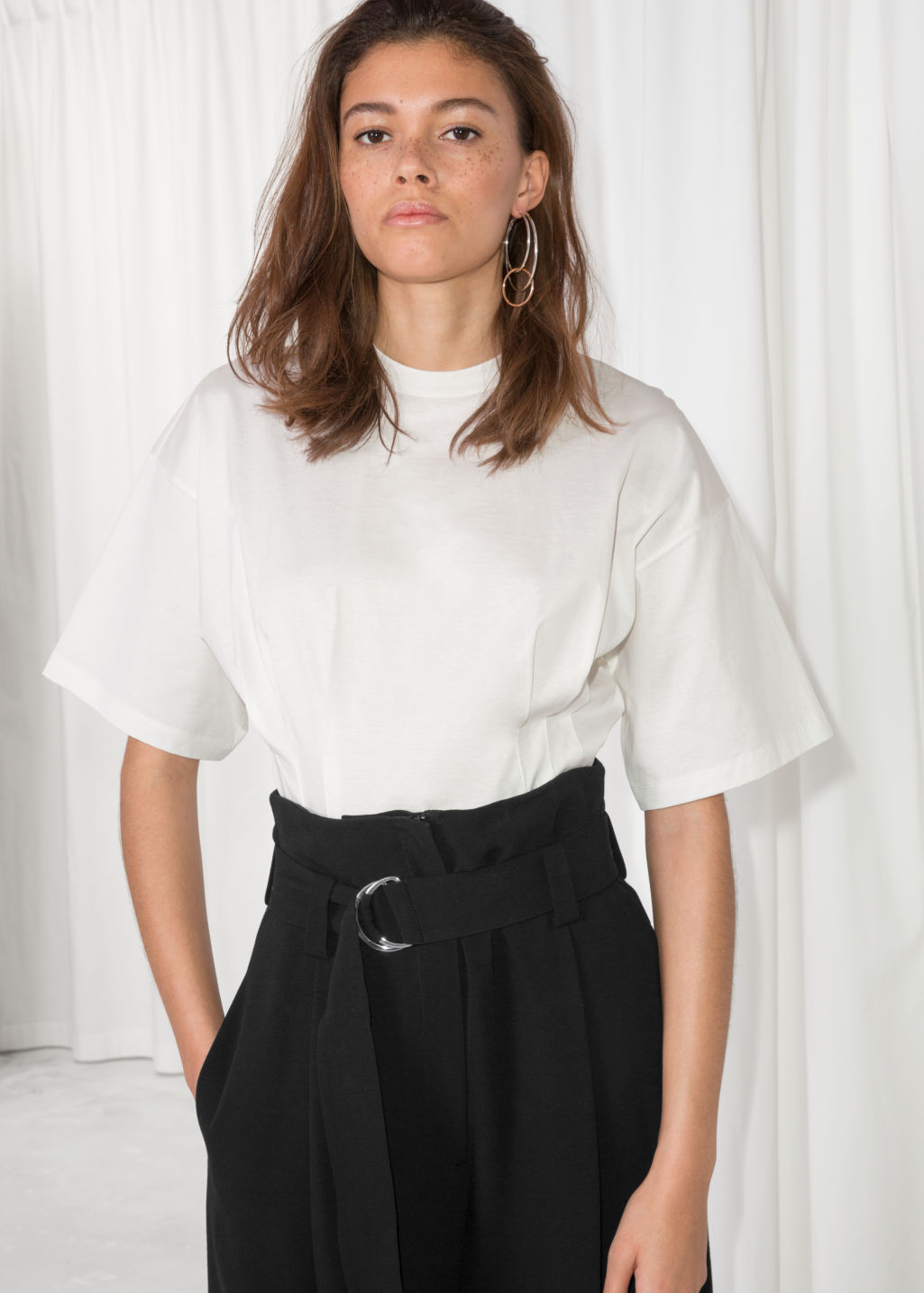 Model front image of Stories pleated t-shirt in white