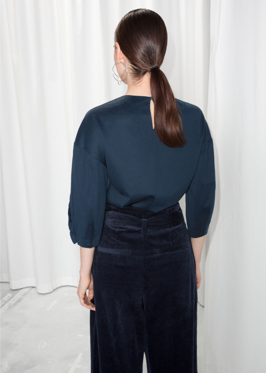 Model back image of Stories ruffle sleeve top  in blue