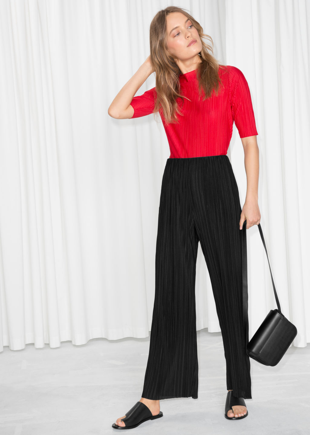 Model front image of Stories raw edge pleated trousers in black