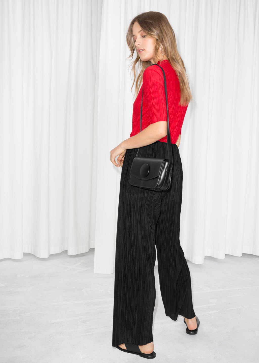 Model back image of Stories raw edge pleated trousers in black