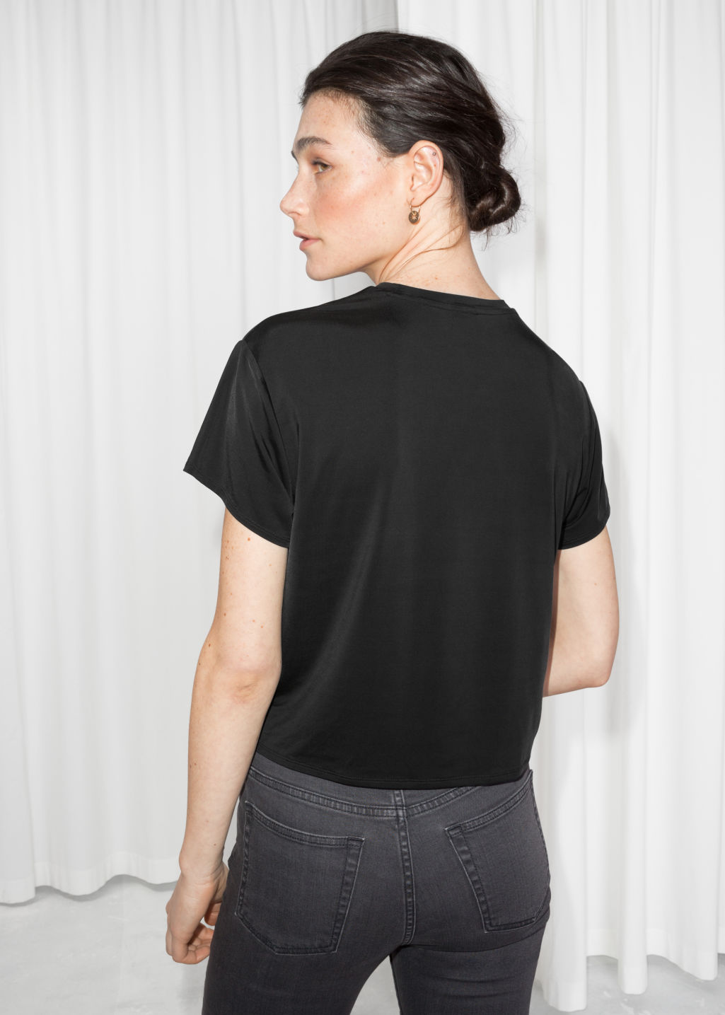 Model back image of Stories twist knot top in black