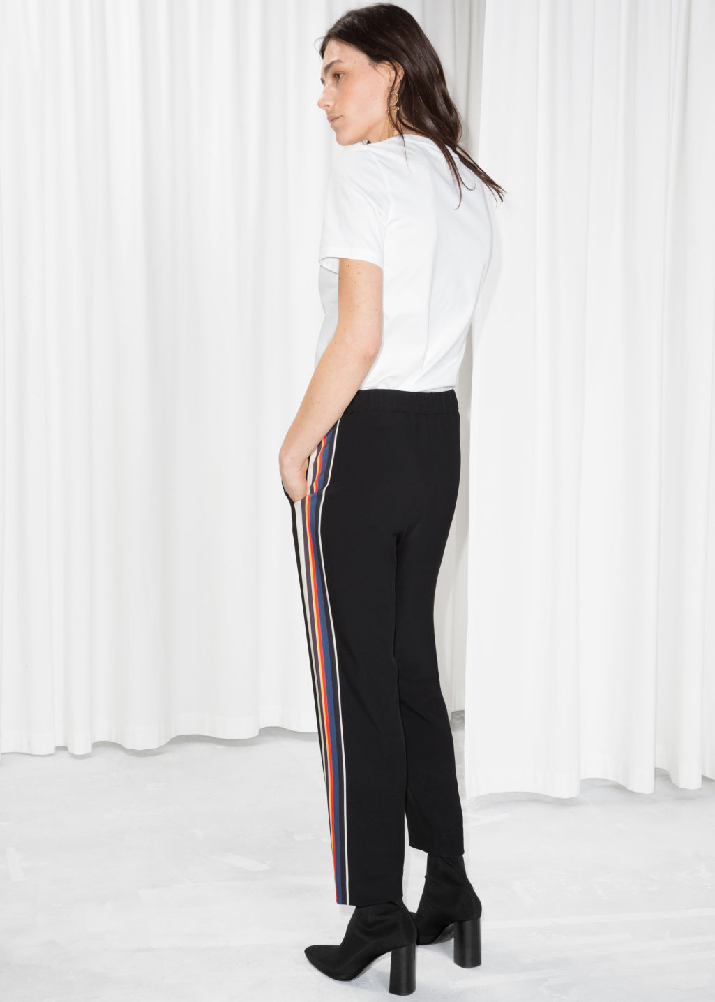 Model back image of Stories tapered racer stripe trousers in black