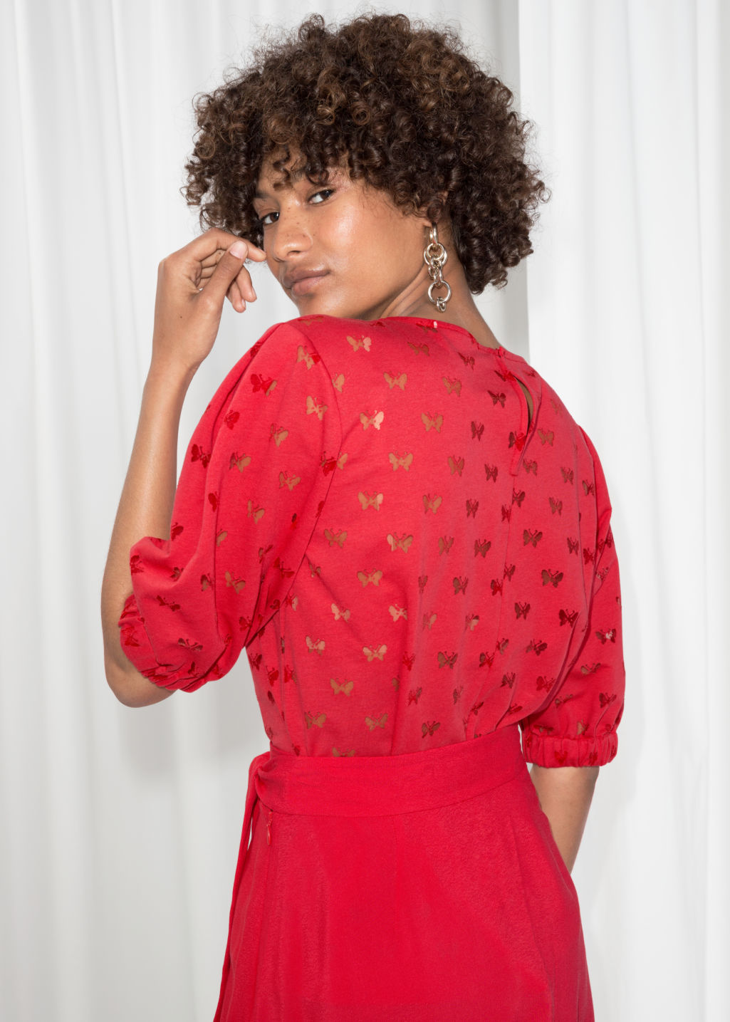 Model back image of Stories butterfly puff sleeve blouse  in red