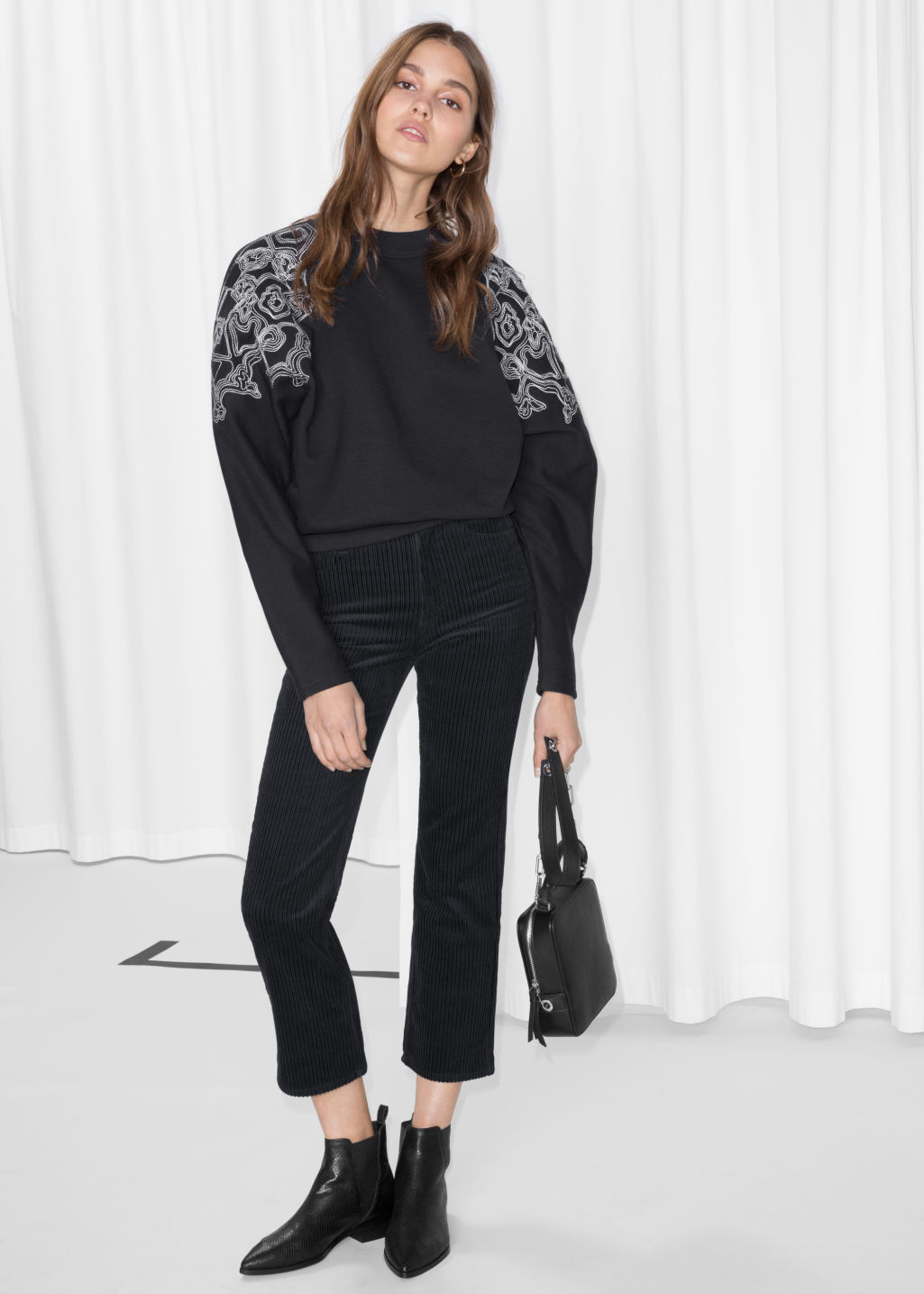 Model front image of Stories cropped corduroy trousers in black
