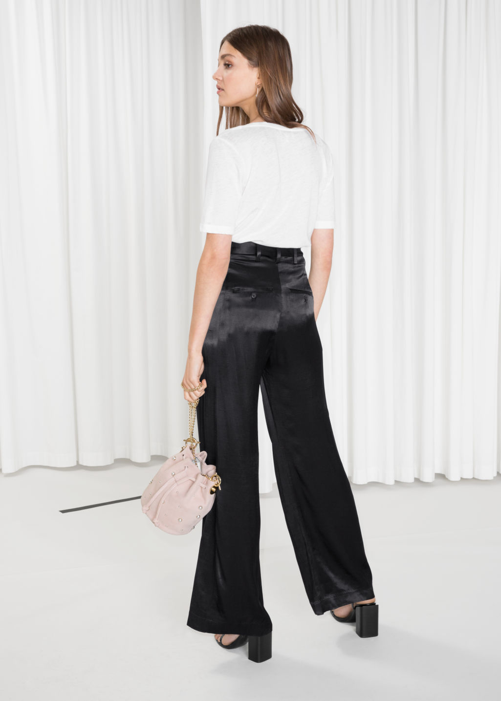 Model back image of Stories high waisted satin flares in black