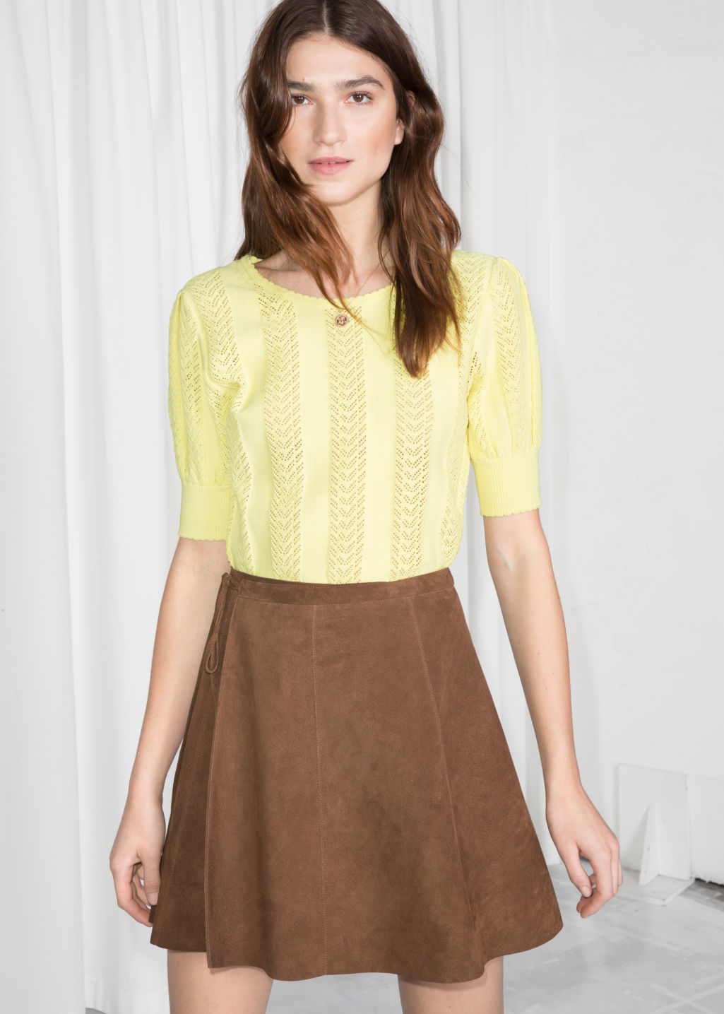Model front image of Stories eyelet knit top in yellow