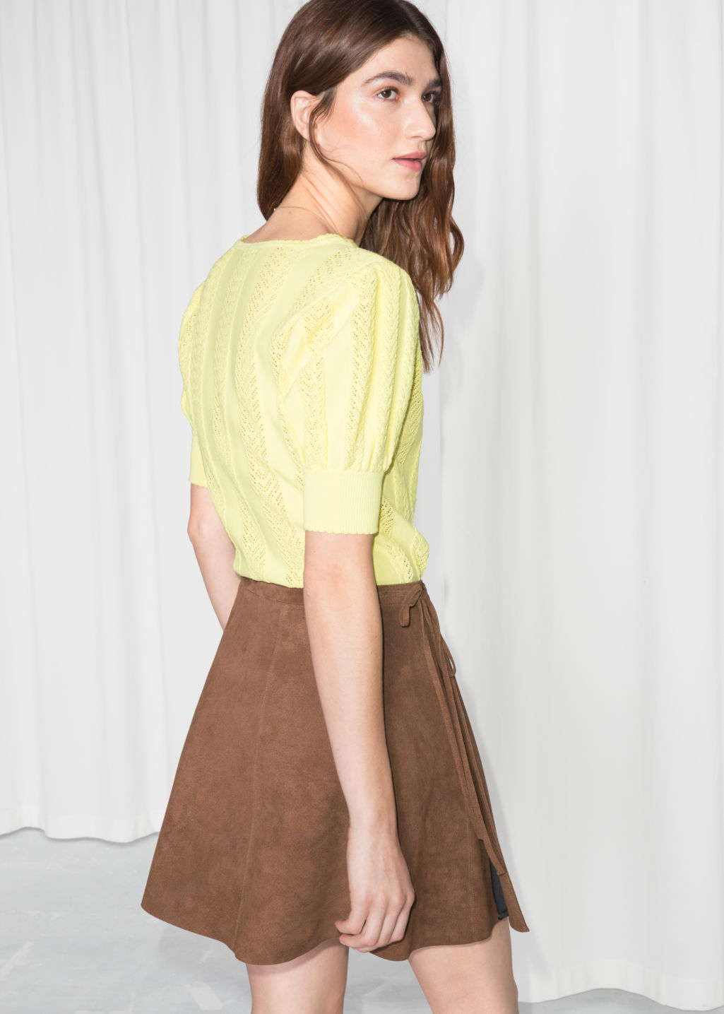 Model back image of Stories eyelet knit top in yellow