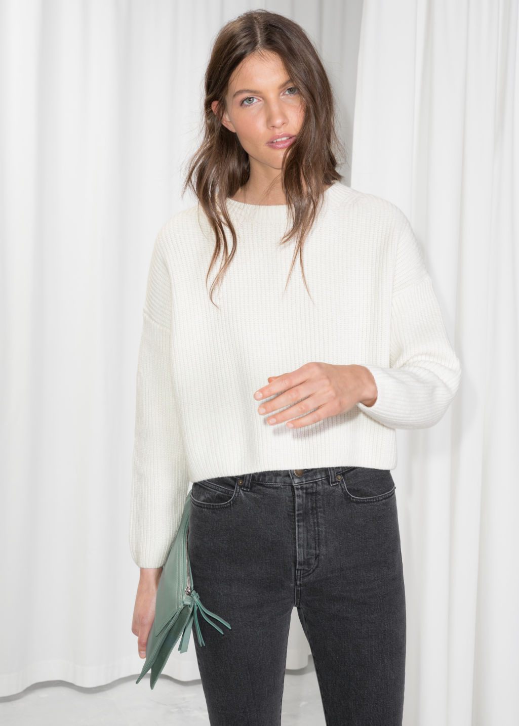 Model front image of Stories cropped crewneck sweater in white