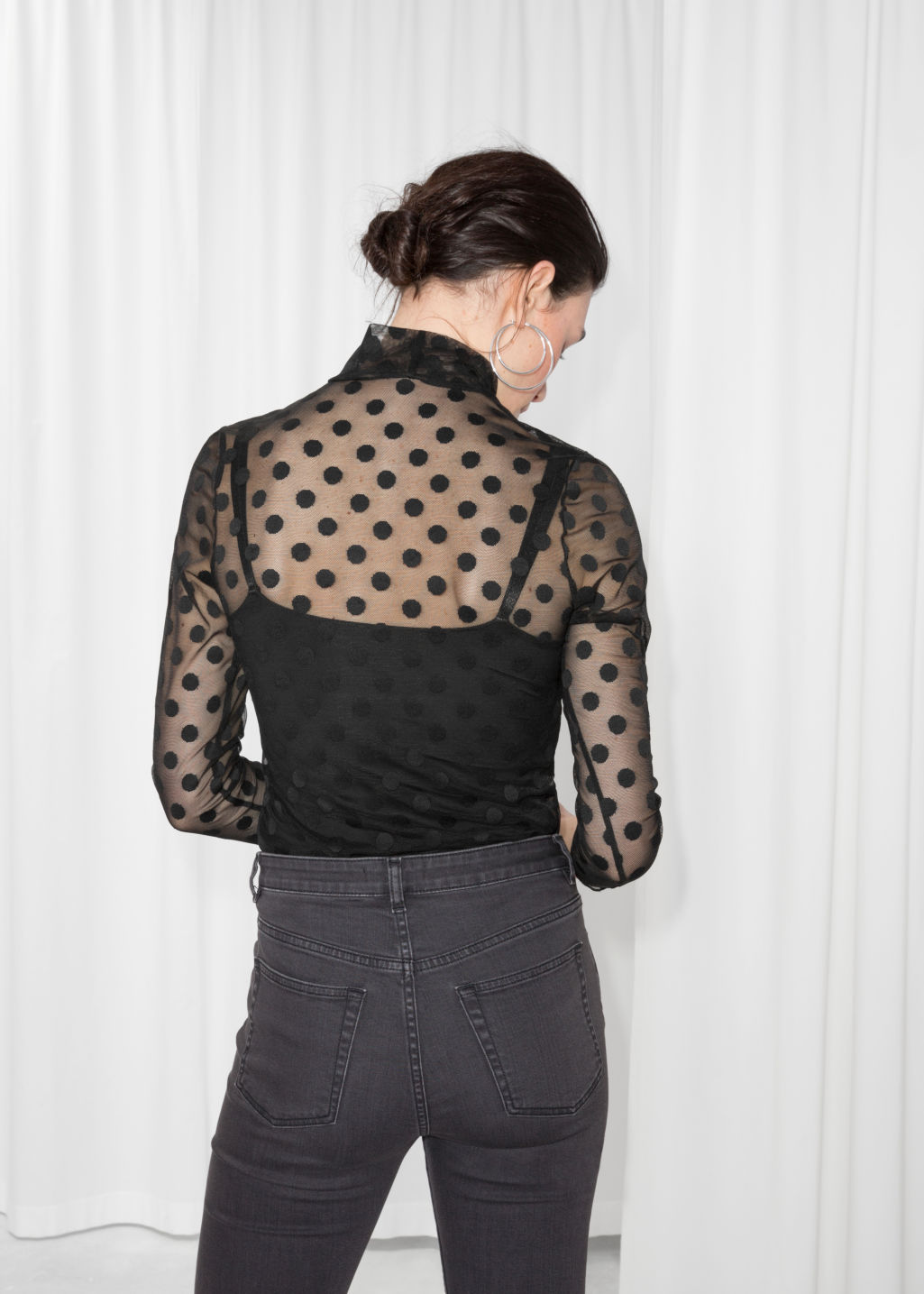 Model back image of Stories sheer turtleneck blouse in black