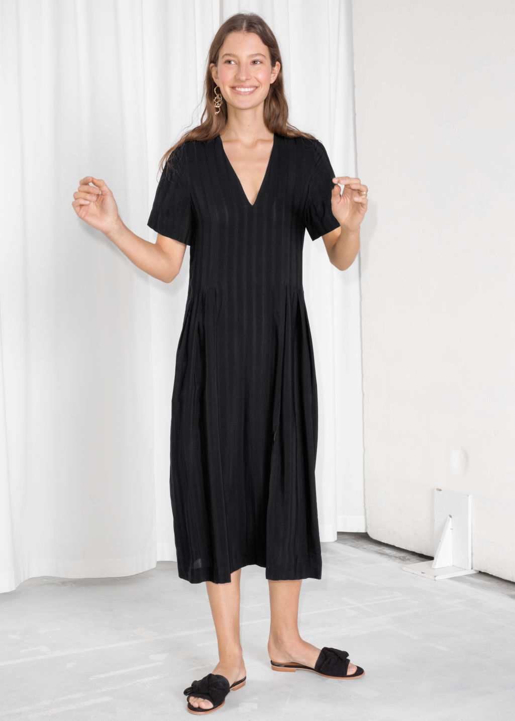 Model front image of Stories midi pleated shirt dress in black